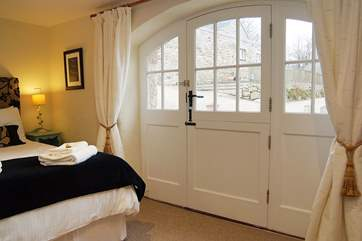 This spacious bedroom is beautifully furnished and has its own en suite shower-room.