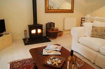 The wood-burner will keep you cosy on those cooler evenings all year round.