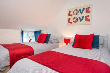 The bright twin bedded room