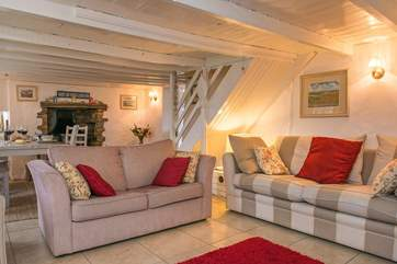 For a traditional cottage, the open plan sitting and dining room is very spacious