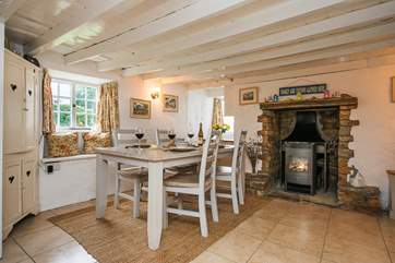 The dining area with its cosy woodburner makes this an ideal retreat whatever the weather