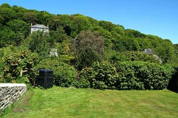 The garden at the side of the cottage leads through to another spacious lawn-area.