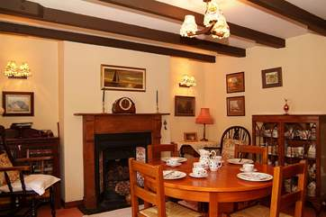 The dining-room with ornamental fireplace.