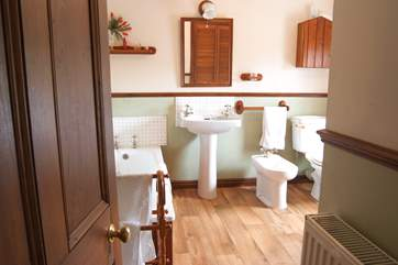 The spacious bathroom includes a separate shower cubicle.