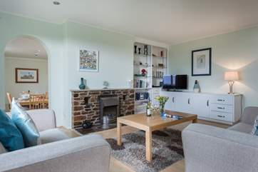 The spacious sitting-room leads through to the dining-room, both with lovely views over the garden.