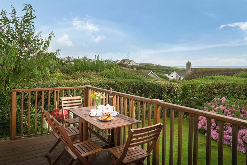 The sitting-room has patio doors opening onto the raised deck (which has steps down to the garden), from where the sea views are best.