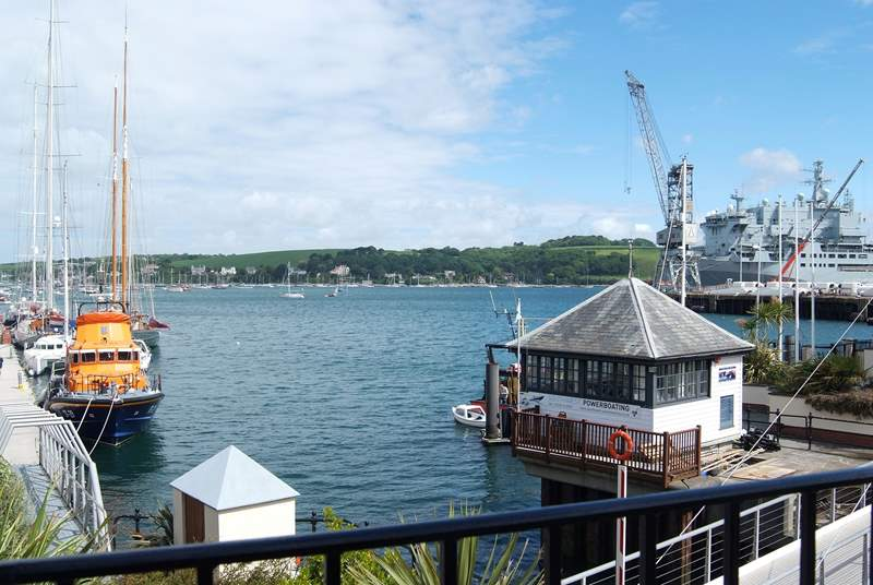 There are fabulous views across the moorings and harbour from the first floor sitting-room, with the lifeboat on the left and an RFA supply ship on the right on the day this picture was taken.