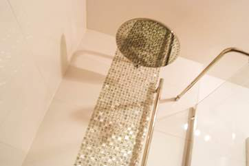 A monsoon shower head in the en suite.