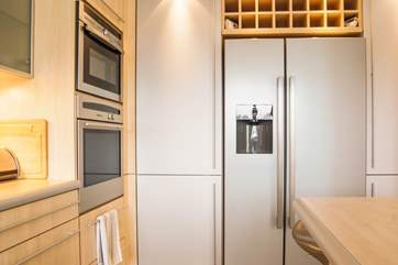 The kitchen has brushed stainless steel and aluminium appliances.