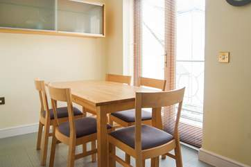 The breakfast-table is by French doors that open onto a balcony.