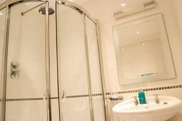 A corner shower in the en suite to Bedroom 2.