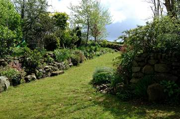 The sheltered garden for the Croft's can be found just across the courtyard, next to the owner's garden.