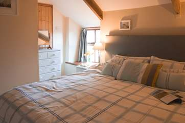 This large comfy bed ensures a good nights sleep after a day out exploring.