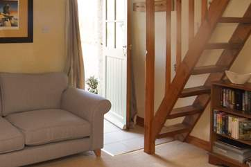 The steep stairs leading up to the spacious bedroom where your super-king size bed awaits you.