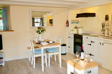 Hand-painted units in the small but well-equipped kitchen-area.