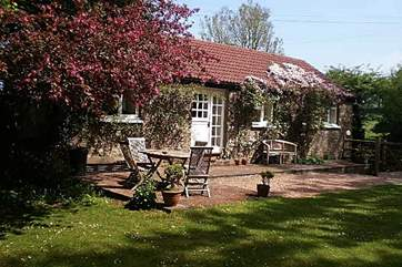 Little Yeo is a very pretty single-storey cottage, covered in clematis in the spring, and with a large enclosed garden.