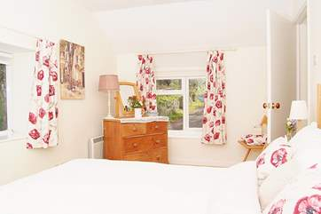 The double bedroom has windows on three sides and so is lovely and bright and cheerful.