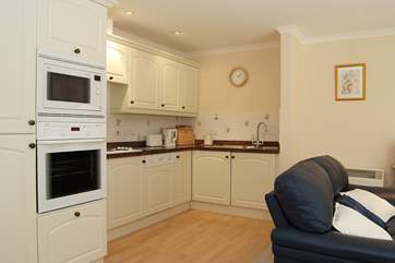 The kitchen-area has granite work surfaces and is fully equipped.