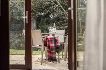 Double doors from the conservatory open onto the patio.