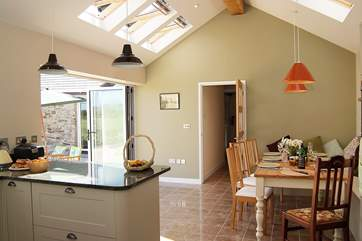 The fabulous open plan kitchen/diner with vaulted ceiling is the hub of the cottage.