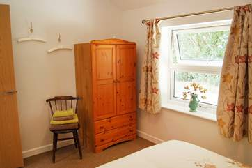 Bedroom two has a view over the quiet lane which only gives access to the Owner's house and a barn next door.