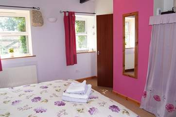 Bedroom 4 has an en suite wet-room (door in the corner) and a small flat screen TV.