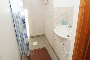 The large wet-room style shower.
