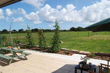The large folding glass doors really make the most of the lovely gardens and wonderful location.