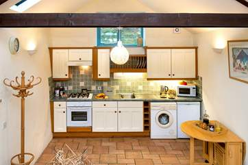 The lovely painted kitchen is very spacious