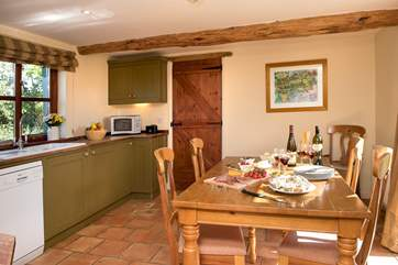 The lovely kitchen/dining-room makes for sociable dining.
