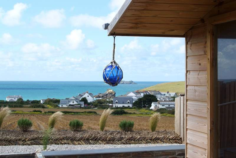 The summer-house at the end of the garden offers a vantage point to view the sea views.