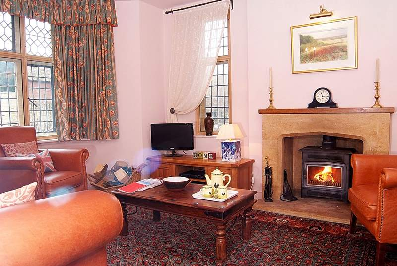 The Lodge has such a comfortable living room, really snug with its wood burning stove and filled with character