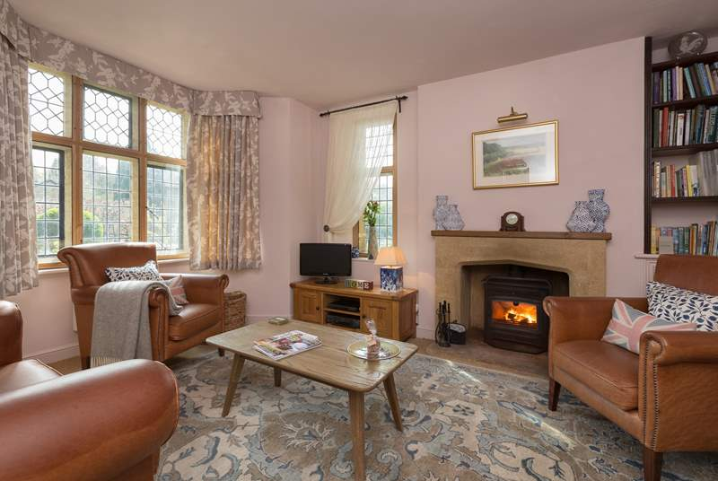 There is a lovely sitting-room with a wood-burner.