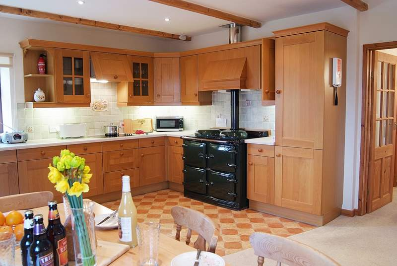 The large, light and spacious kitchen/dining-room in the heart of the home.