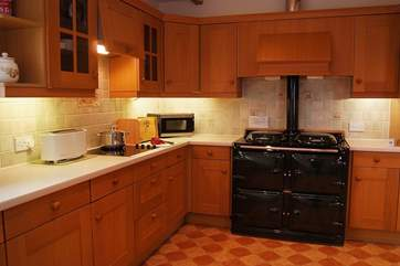 The large kitchen is well-equipped and includes an oil-fired Alpha range cooker for those home cooked meals.