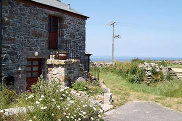 The footpath to the cliffs runs past the cottage.