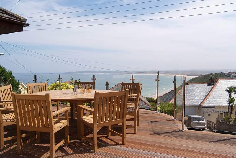 The sitting-area has stunning sea views over the rooftops.