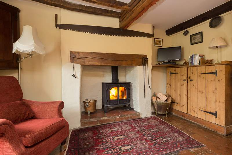 The living room with wood-burner could not be more cosy and welcoming. The cottage is filled with character.