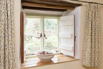 Handmade shutters add to the cosy feel of this welcoming little cottage.