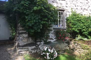 There is a very pretty little front garden as well as the larger side garden which has the barbecue.