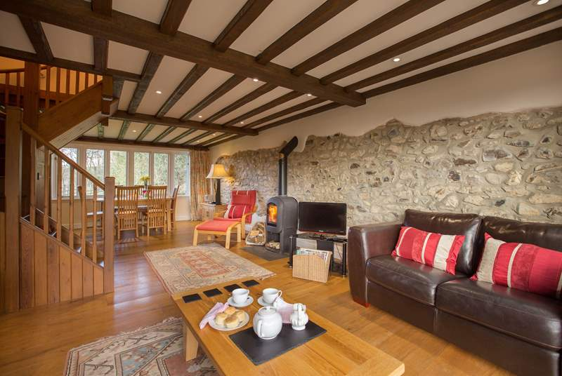 There is a beautiful living/dining-room with a wood-burning stove and French windows to the enclosed garden.