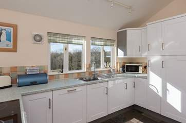 The dual-aspect kitchen makes the most of the amazing views from the cottage - all the way to Dartmoor!