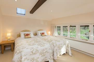 This is the second bedroom - also with a fabulous view towards the farmstead and the valley beyond it.