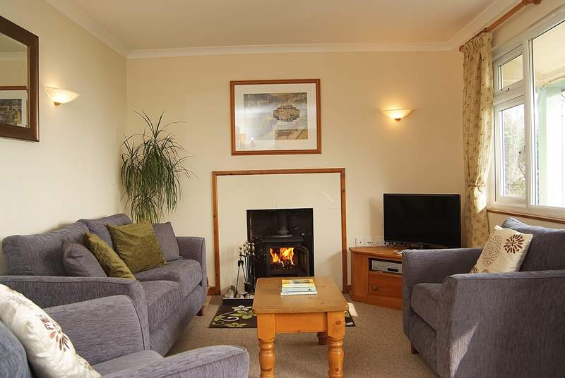 The sitting-room has a wood-burner for cooler evenings.