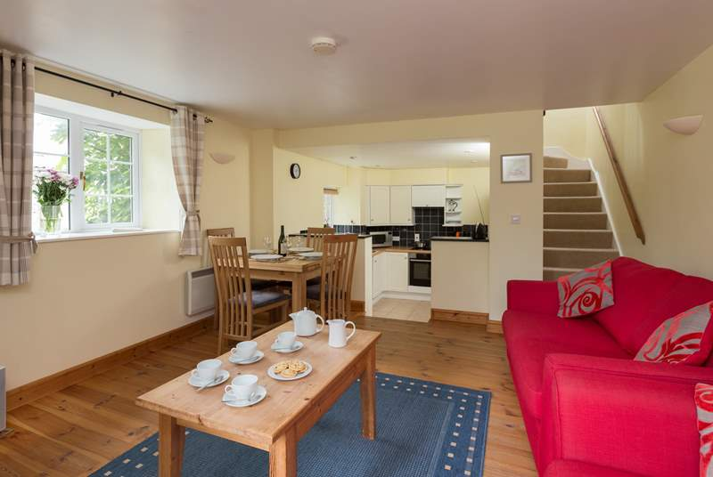 The ground floor is a cheerful open plan layout, with steps down to the kitchen area.