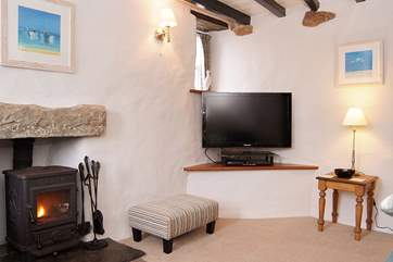 A roaring wood-burner in each sitting-room makes this cottage cosy and warm.