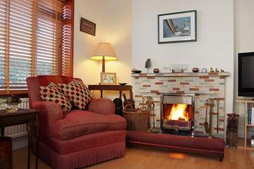 The sitting-room is very comfortably furnished.