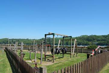 The children's play-park in Golant, safely fenced by the inner harbour.