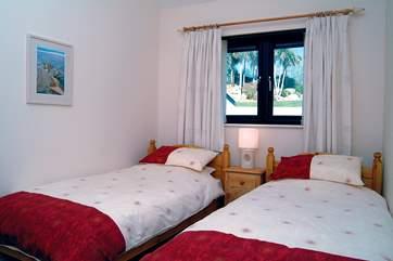The second bedroom has twin beds (Bedroom 1).