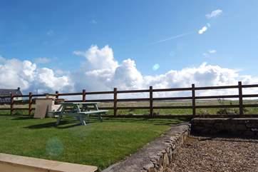 The garden has views across open countryside.